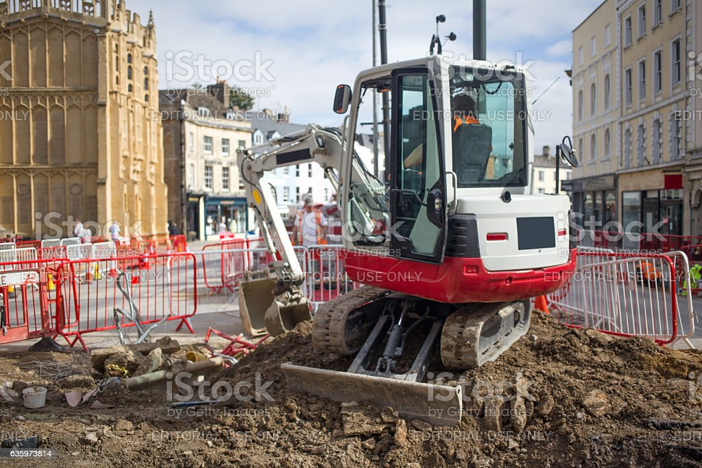 Mini digger working on a town regeneration scheme stock photo