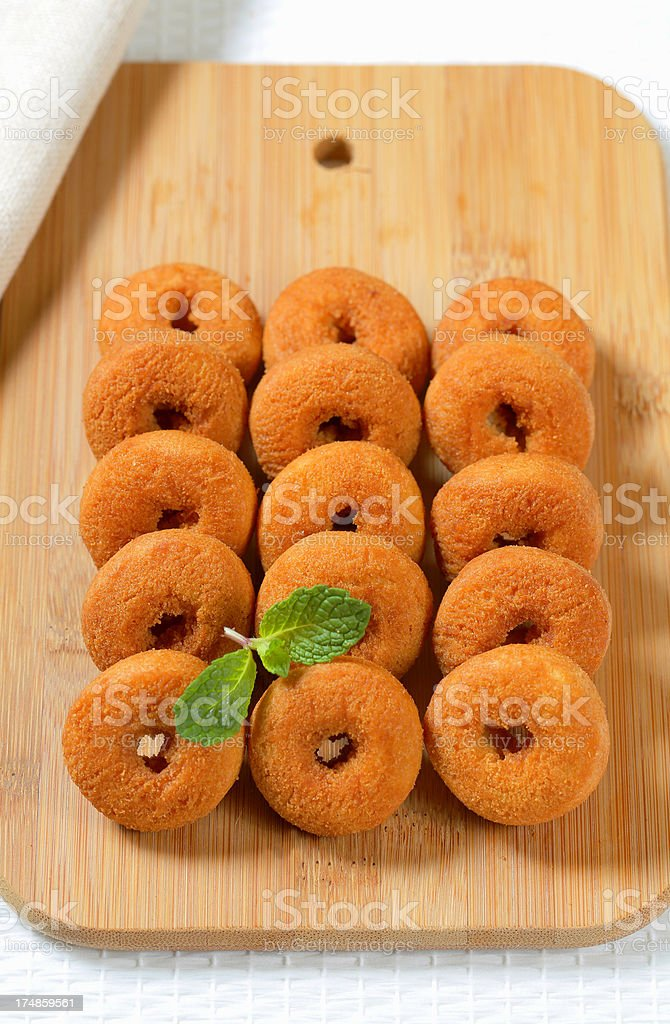 Mini donuts on a cutting board royalty-free stock photo