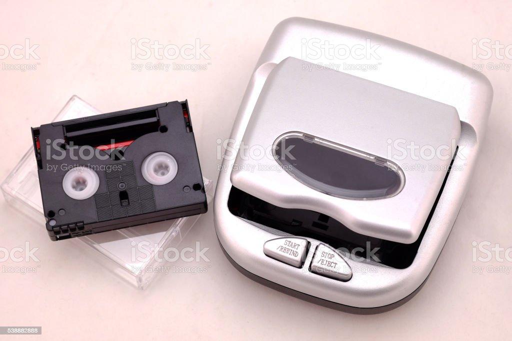 mini DV Cassette  and mini DV Cassette Rewinder stock photo