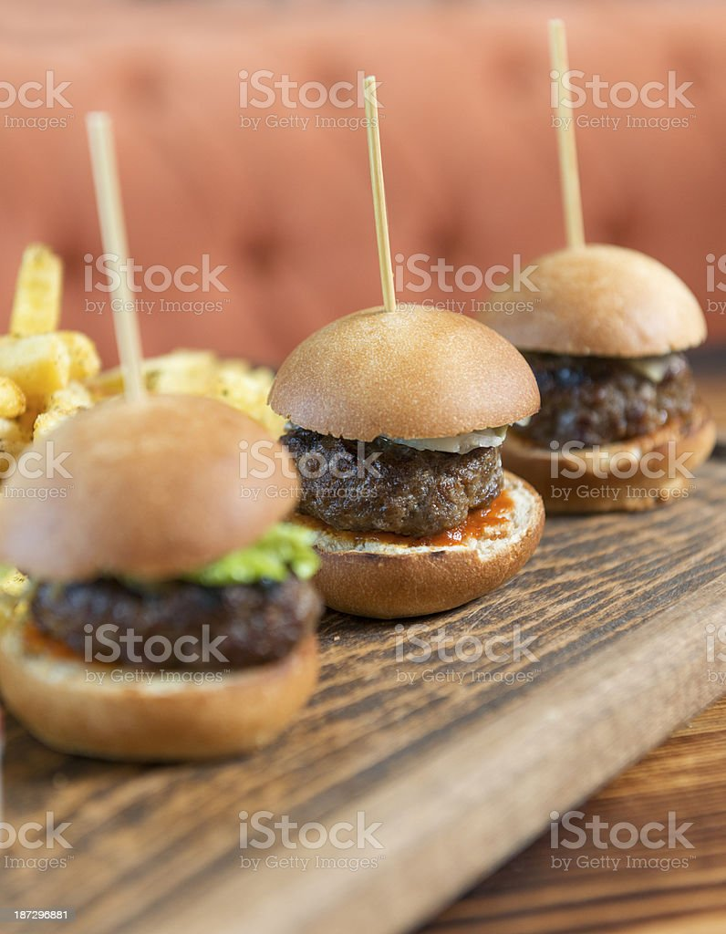 Mini hamburger and French fries with toothpicks stock photo