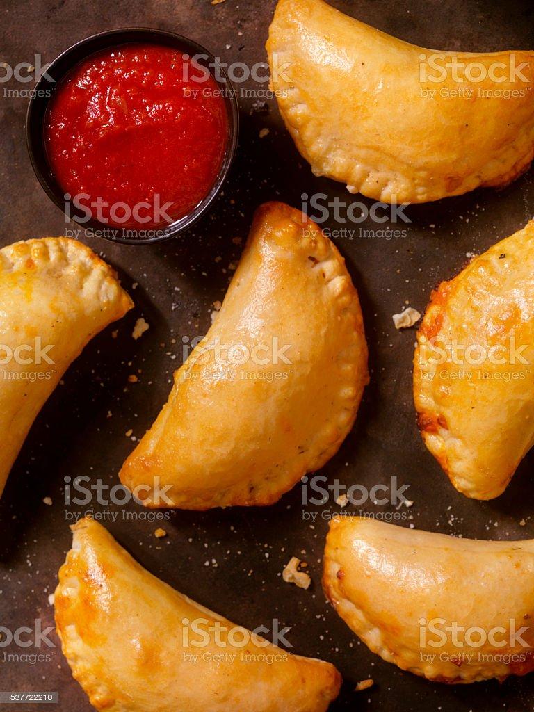 Mini Homemade Calzones with Marinara Sauce stock photo