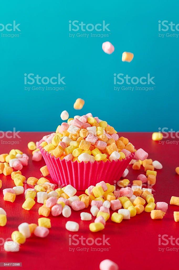 Mini marshmallow on vibrant background. stock photo