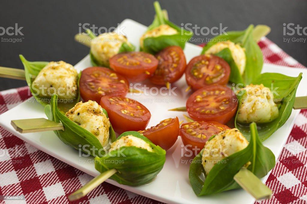 mini mozzarella with basil and cherry  tomato stock photo
