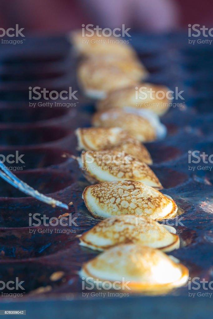 mini pancakes cooking on open baking plate stock photo
