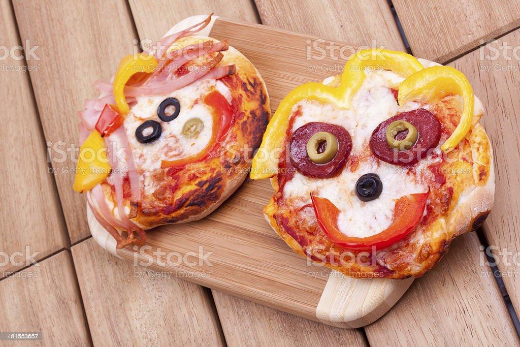 mini pizza, face on pizza stock photo