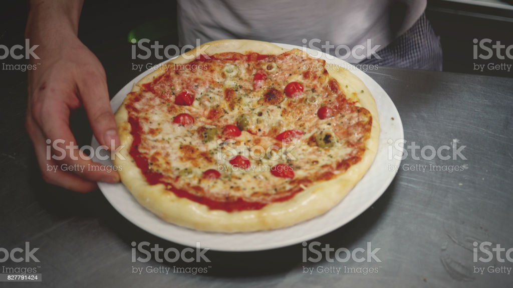 Mini pizza on the plate stock photo