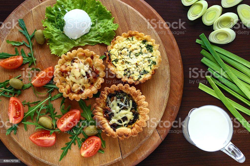 Mini Quiche on wooden plate stock photo