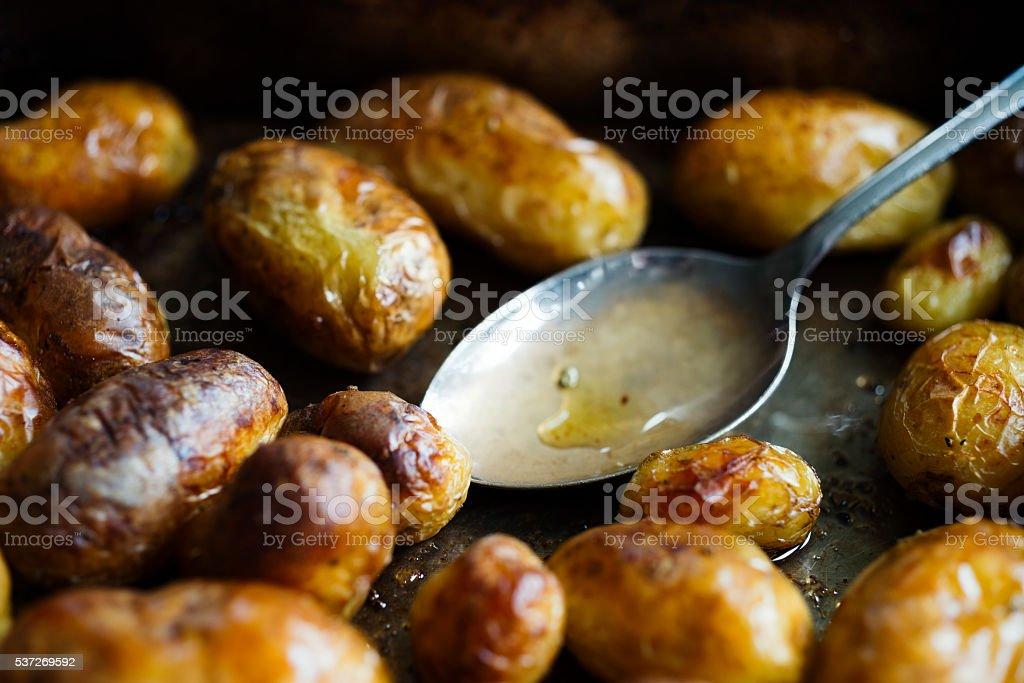 mini roasted new potatoes stock photo