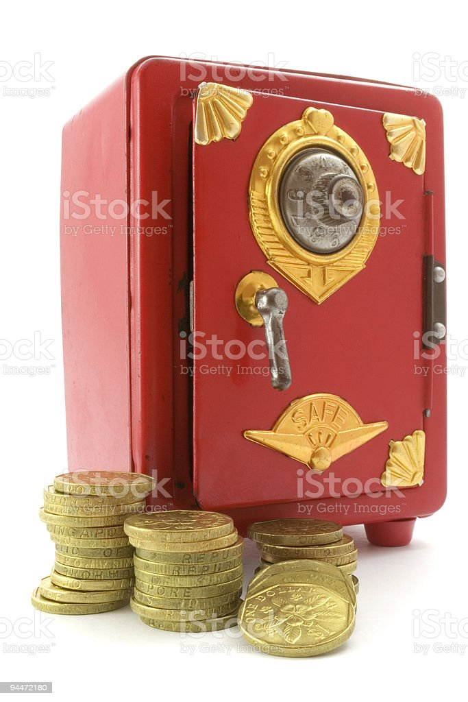 Mini safe and gold coins stock photo
