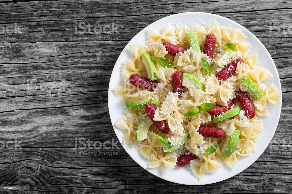 mini salami Bowtie Pasta warm salad sprinkled with grated parmes stock photo