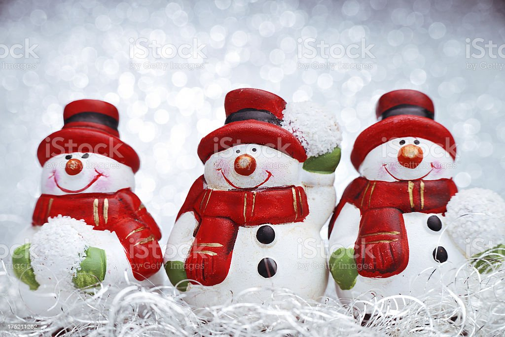 Mini snowman figurines with illuminated background royalty-free stock photo