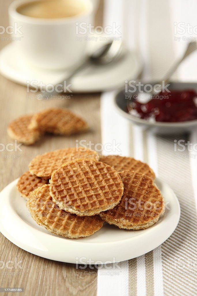 Mini stroopwafels (syrupwaffles) with cup of coffee and jam stock photo