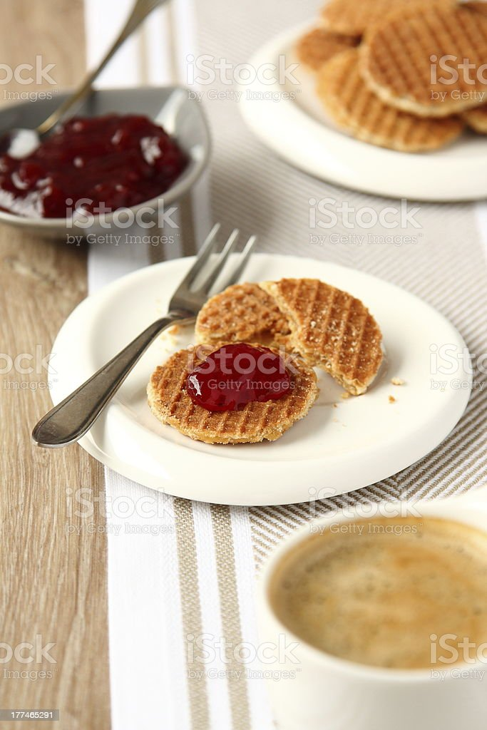 Mini stroopwafels (syrupwaffles) with cup of coffee and jam royalty-free stock photo