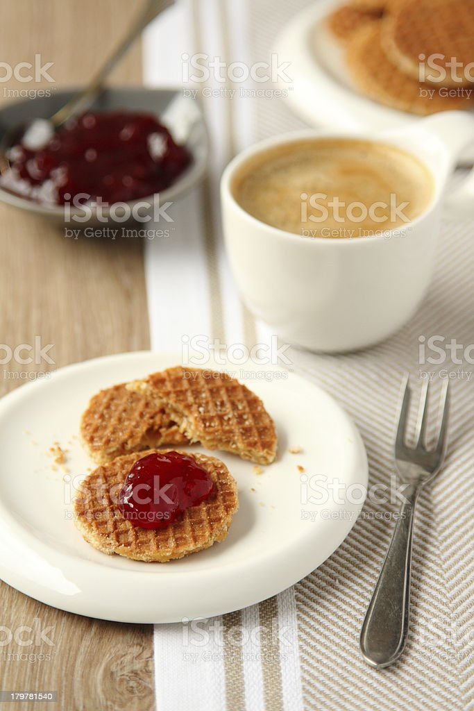 Mini stroopwafels (syrupwaffles) with jam and cup of coffee stock photo