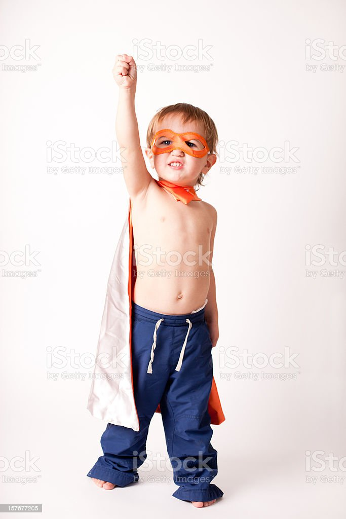 Mini Superhero! Little Boy Wearing Cape and Mask Showing Fist royalty-free stock photo