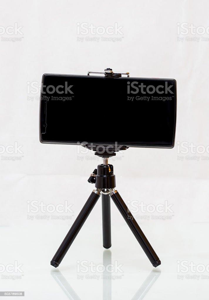 Mini Tripod with smartphone stock photo