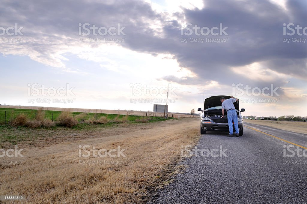 Mini Van with Car Trouble on a Small Rural Highway stock photo
