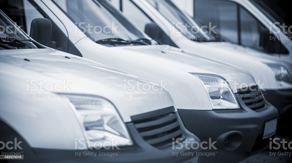 Mini vans in a row at parking lot stock photo