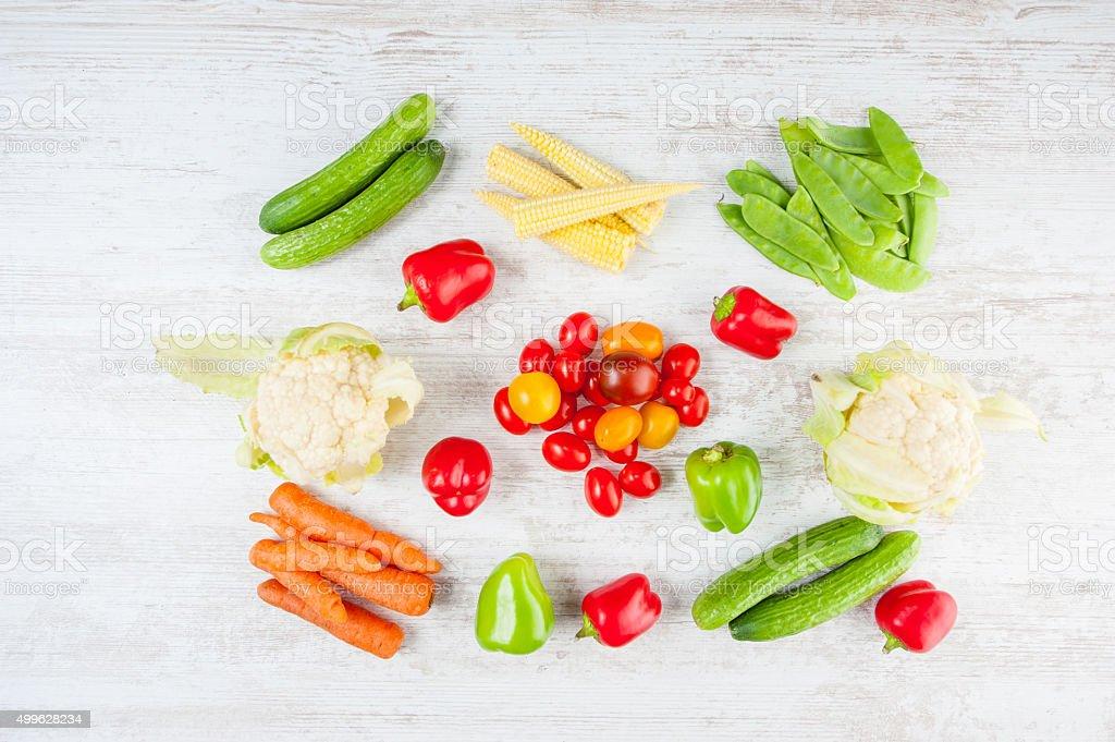 Mini vegetables on wood countertop stock photo