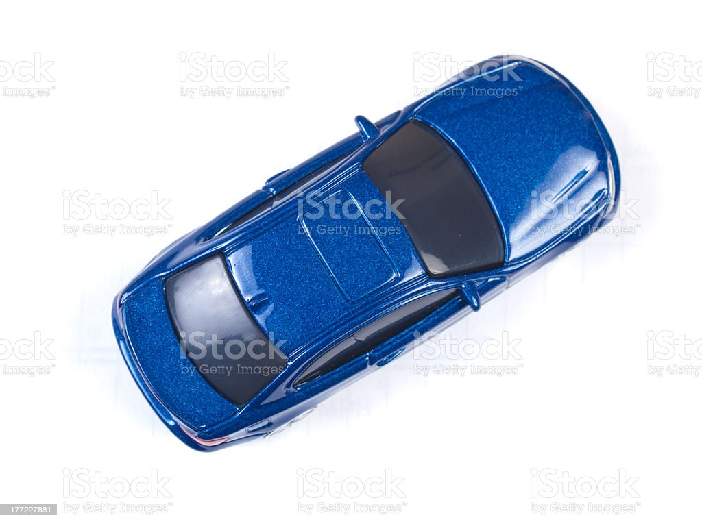 A miniature blue toy car on a white background stock photo