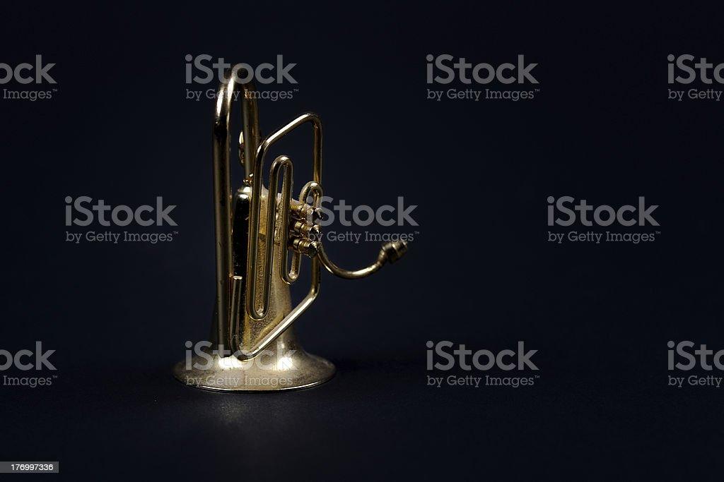 Miniature brass instrument on black background royalty-free stock photo