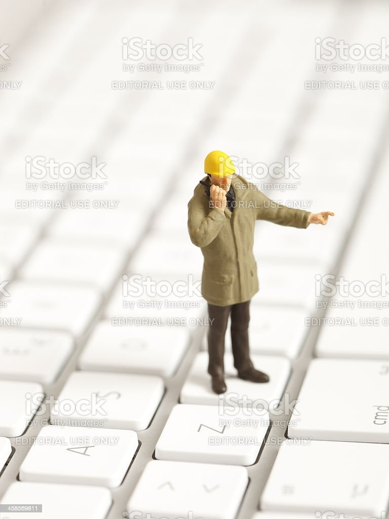 Miniature building contractor on a keyboard royalty-free stock photo