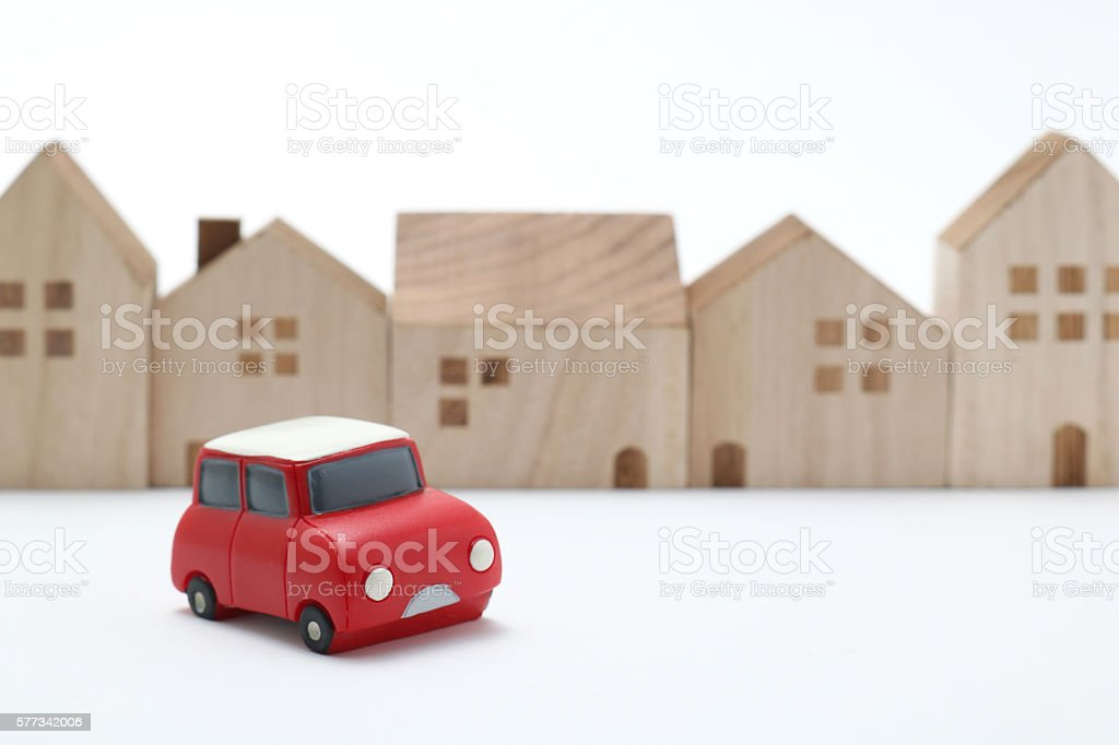 Miniature car and houses on white back ground. stock photo