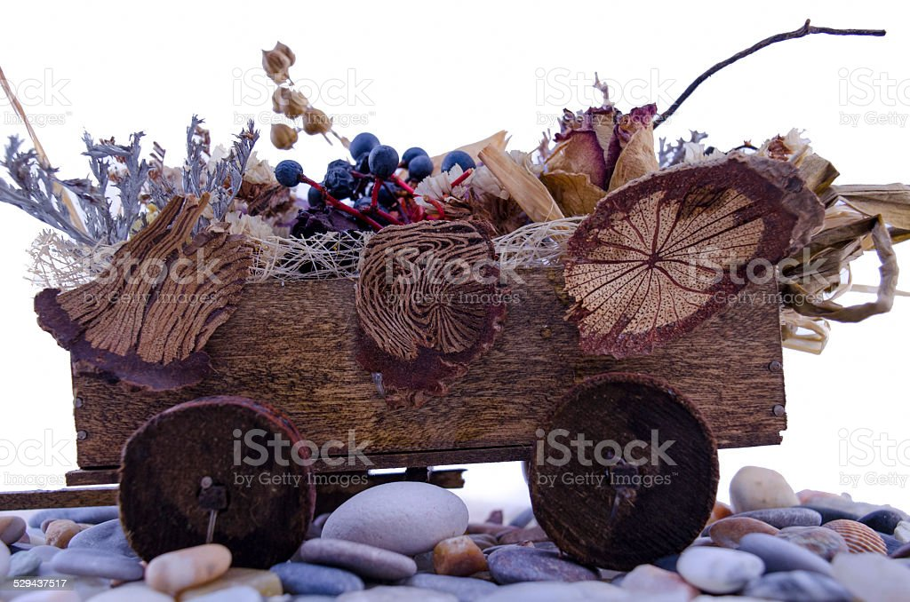 Miniature cart filled with flowers royalty-free stock photo