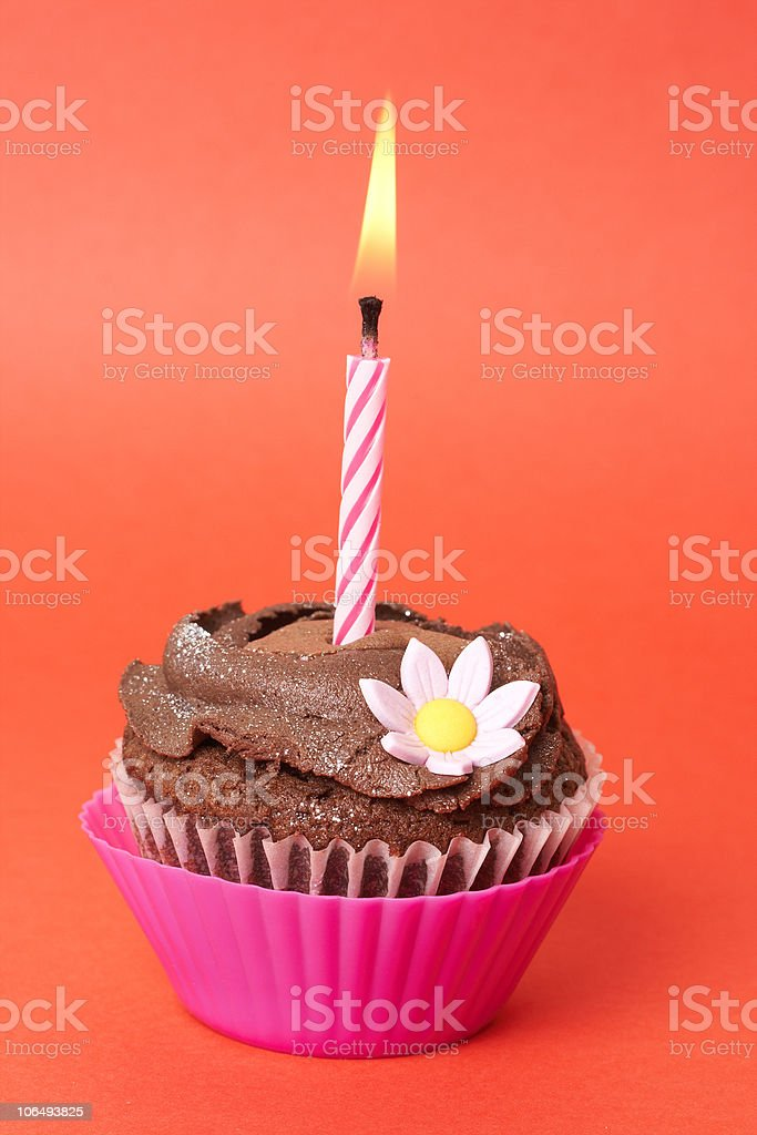 Miniature chocolate cupcake with candle royalty-free stock photo
