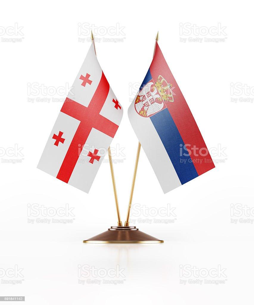 Miniature Flag of Georgia and Serbia stock photo