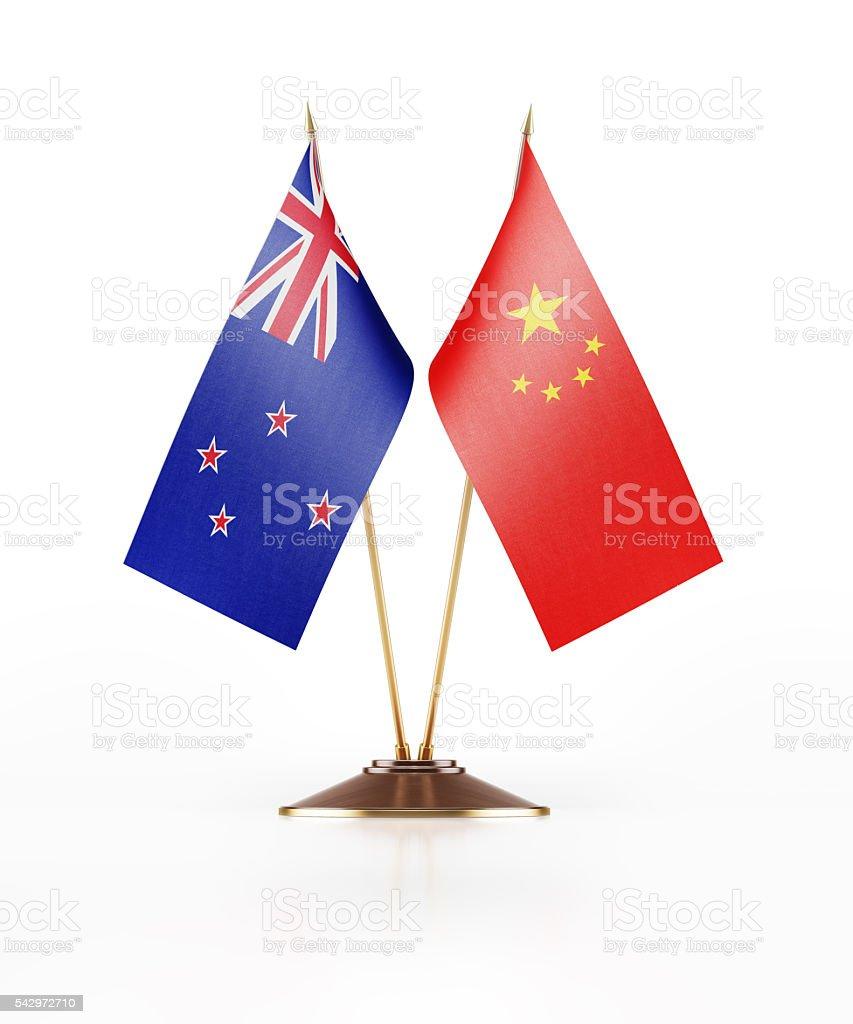 Miniature Flag of New Zealand and China stock photo