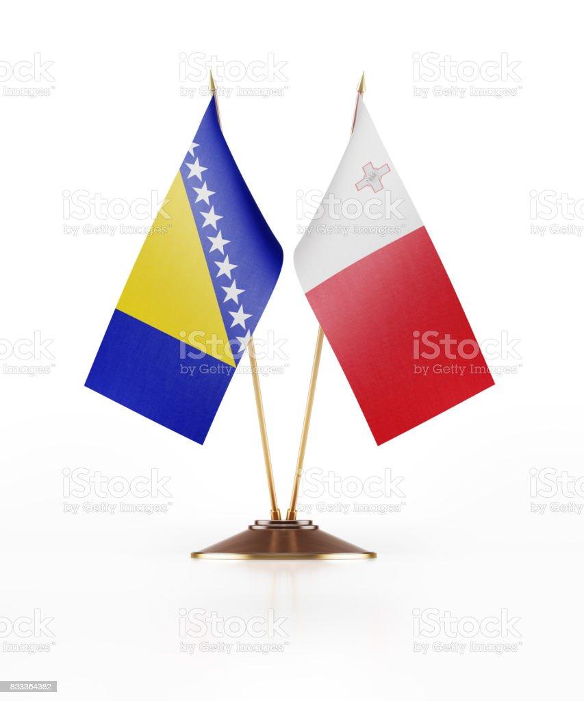 Miniature Flags of Malta and Bosnia Herzegovina stock photo