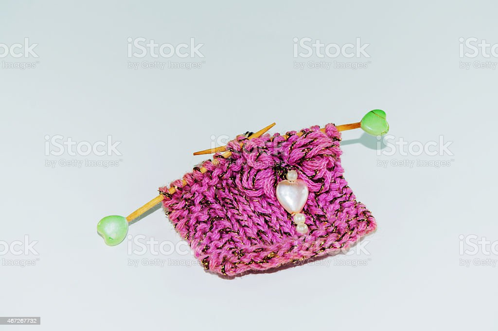 Miniature hand-knitted stock photo