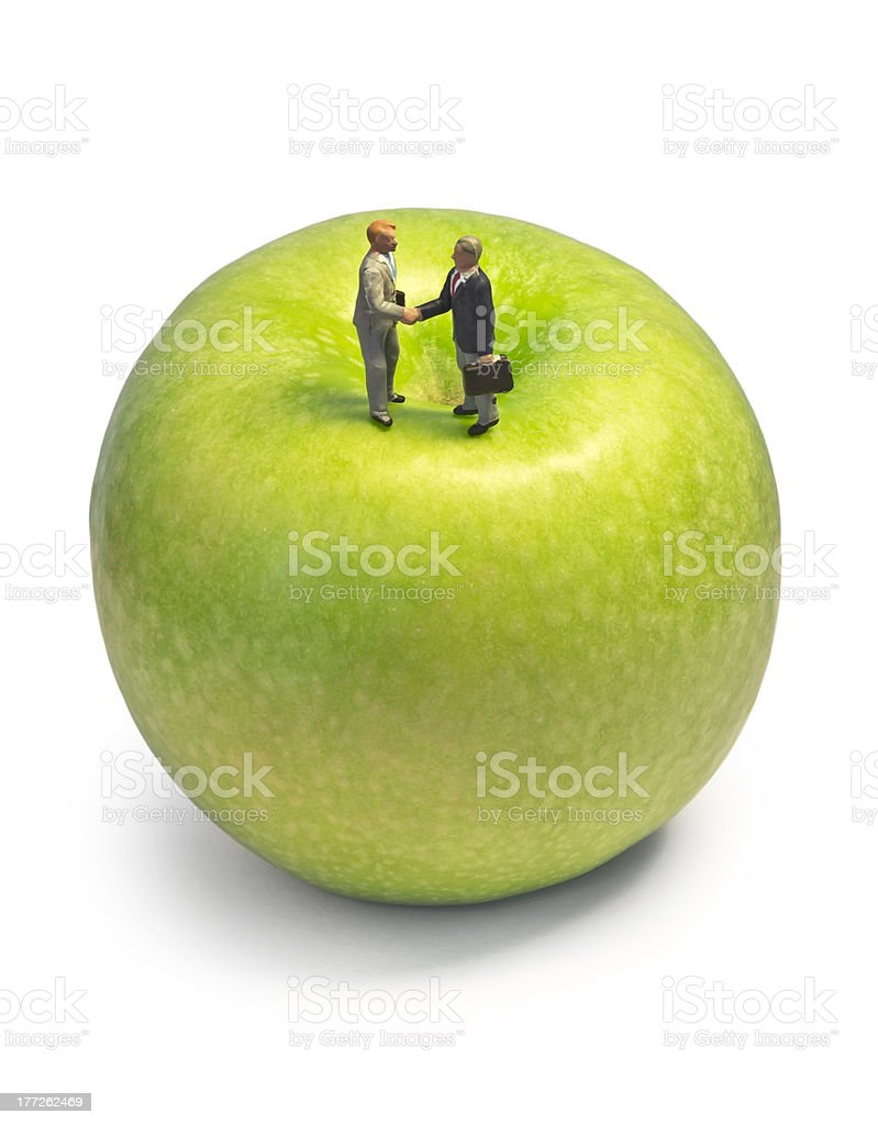 Miniature handshake apple royalty-free stock photo