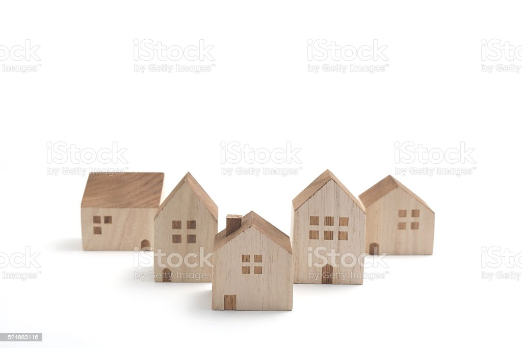 Miniature houses on white background. stock photo