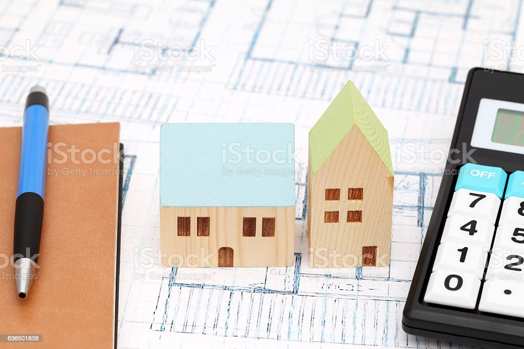 Miniature model of house on blueprints stock photo
