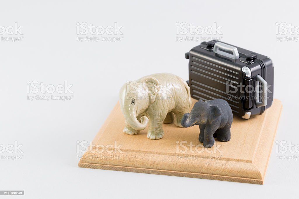 Miniature of an elephant and the suitcase stock photo