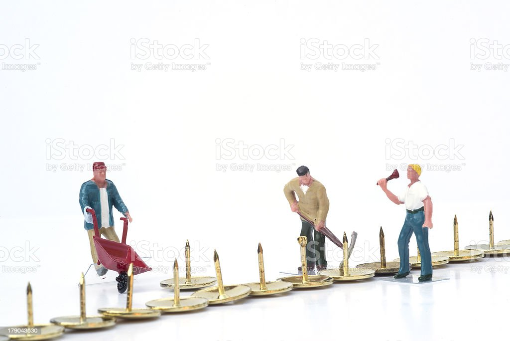 Miniature people teamwork overcoming obstacles business concept stock photo