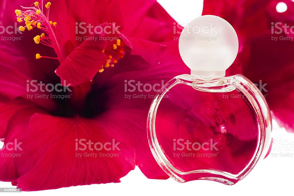 Miniature perfume bottle with a hibiscus flower royalty-free stock photo