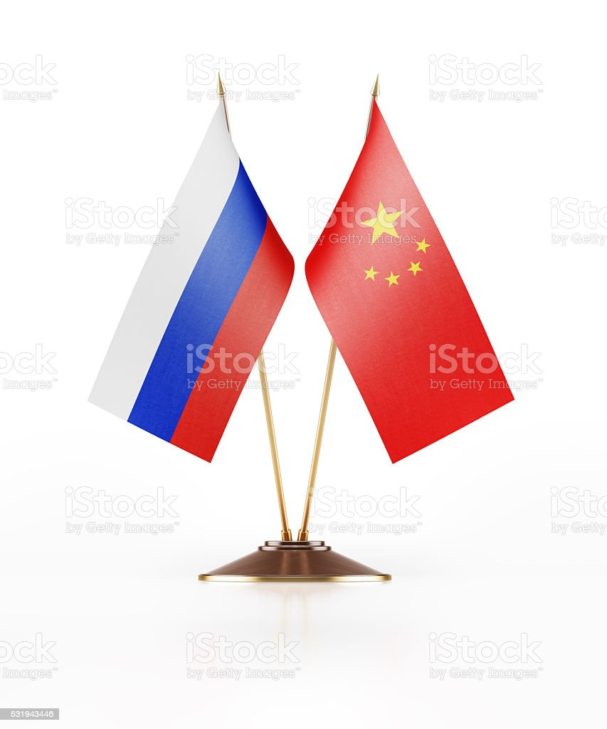 Miniature Russian and Chineese Flag On White Background stock photo