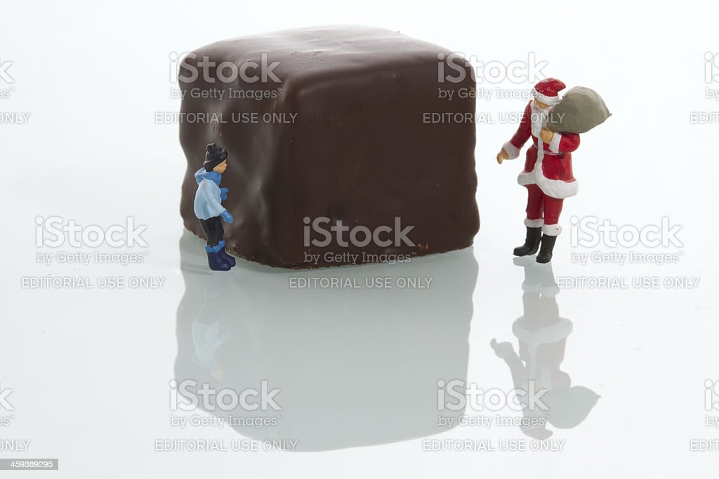 Miniature Stanta and Child with Chocolate Candy. royalty-free stock photo