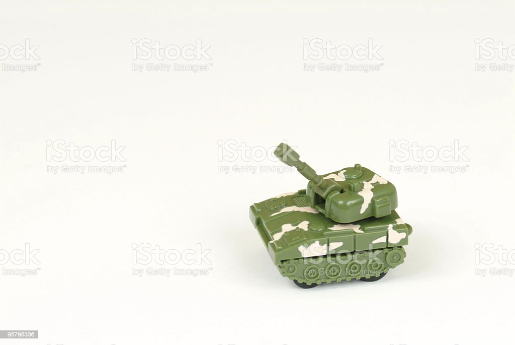 Miniature toy tank isolated on white royalty-free stock photo