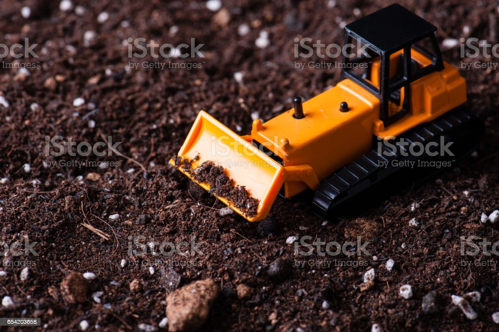 Miniature yellow tractor stock photo