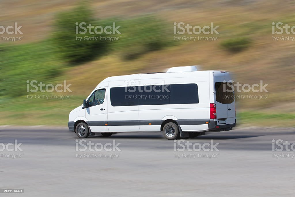minibus moves on the highway stock photo