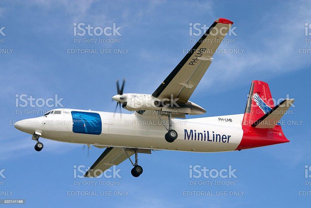 Miniliner F-50F on short finals runway 31. stock photo