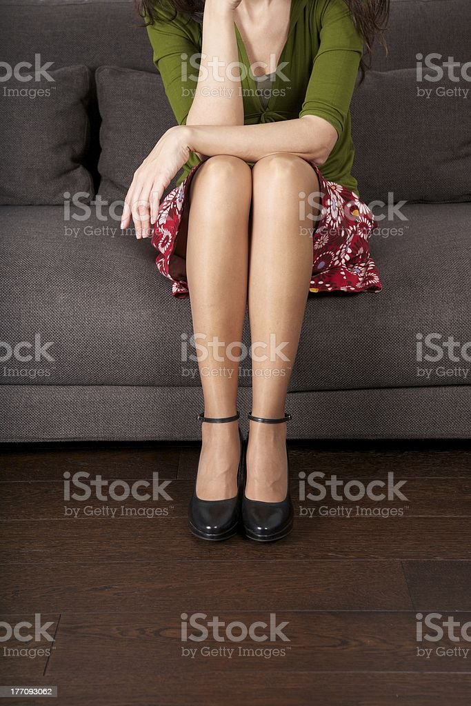 minimal heeled black shoes sitting on sofa royalty-free stock photo