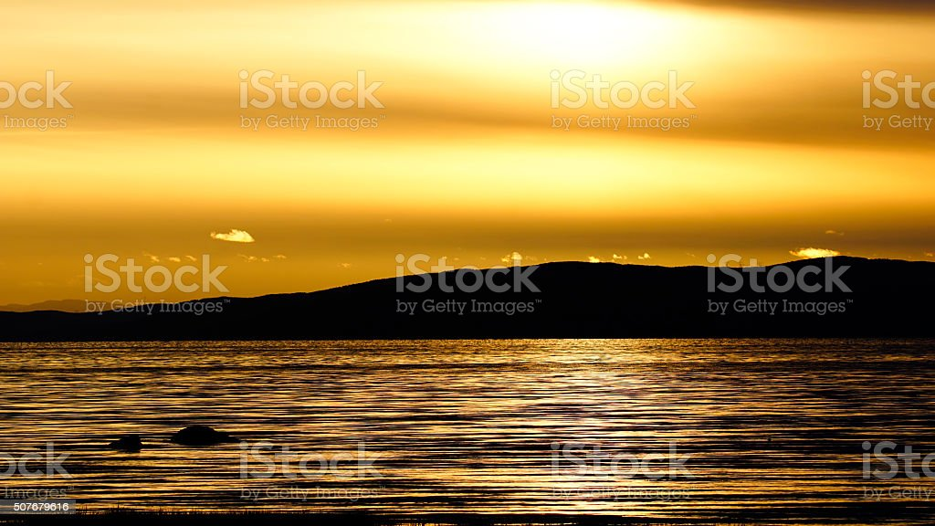 Minimalism composition, golden sunset, St. Lawrence River stock photo