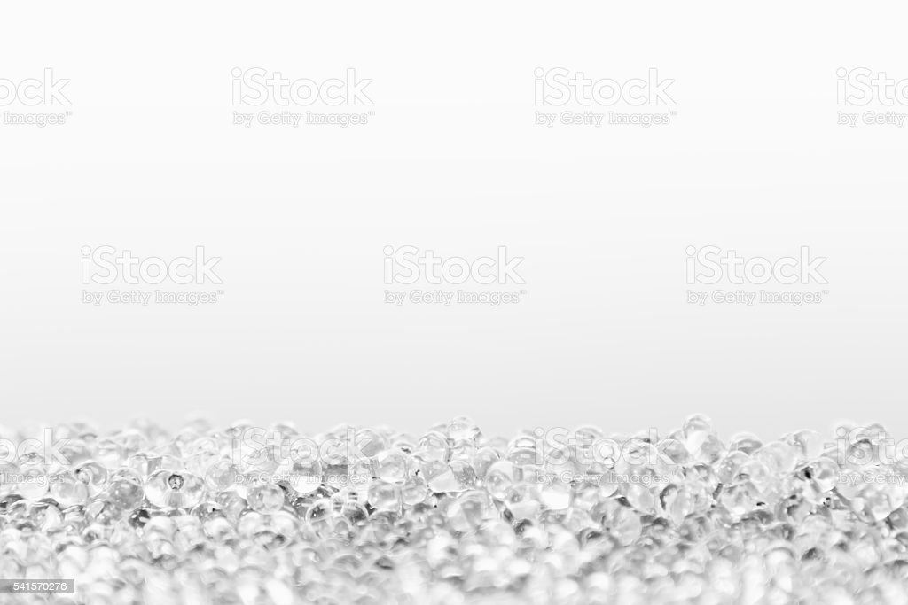 Minimalist abstract light background with transparent glass particles. stock photo