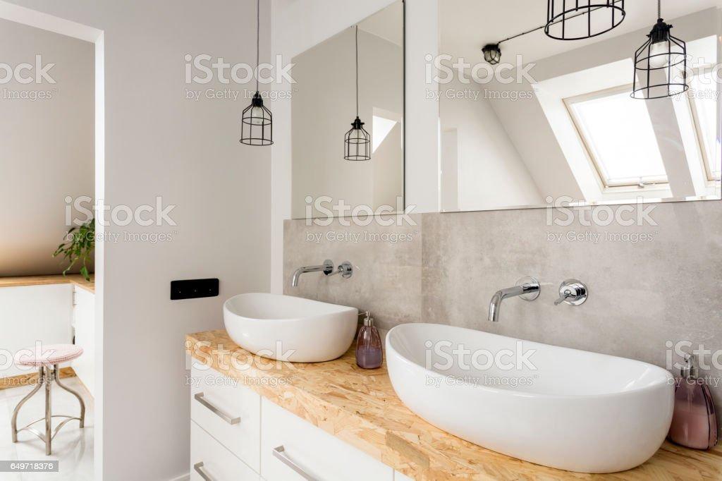 Minimalist bathroom with two sinks stock photo