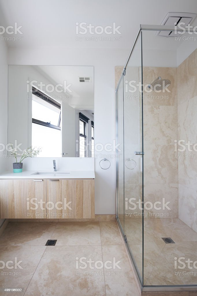 Minimalist beige contemporary bathroom in luxury Australian home stock photo
